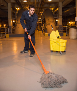 Janitor mopping factory floor